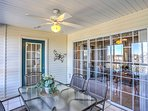 The lovely condo offers a sunroom with a nice table, great for dining and playing games.