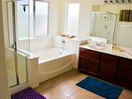 The on-suite master bathroom has a separate tub and shower