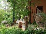 Garden sculptures around cottage