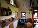 Living area, kitchenette & stairs to loft