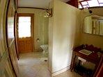 Bathroom - shower, toilet, handbasin & storage/hanging space