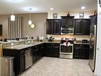 Kitchen- upgraded granite counter tops, stainless steel appliances, fully stocked pots, pans, dishes