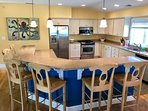 Top floor chef's kitchen with island that seats 6 and gas cooktop