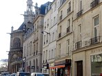 Rue Montmartre and the apartment's facade.