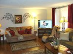 Living Room has 3 sofas (1 is queen sleeper), gas log fireplace, massage chair, HDTV