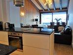Open plan kitchen, granite work tops, ceramic hob, breakfast bar