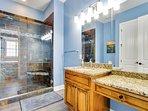Master bath Luxury overhead rain shower with themo-static shower temperature controls