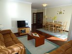 Lounge/dining area, and dining room with table and 6 chairs, lounge area with 2 settees, smart TV