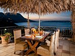 Enjoy your dinner under the palm umbrella
