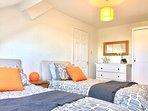 Stylish twin bedroom with plenty of storage space.