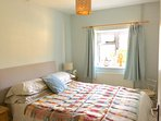 Quiet & comfortable kIng size bedroom, built in wardrobe and drawers, adjacent to family bathroom.