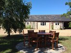 Outside seating area to enjoy a coffee or glass of wine, with portable BBQ for summer evenings.