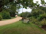 Benches are dotted around the 5 acres of wildlife ponds and gardens which attract many rare birds.