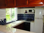 Fully equipped kitchen with Toaster, Blender,Juicer, Coffee Maker and Microwave.Custom Wood Cabinets