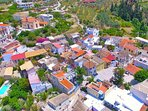 Aerial view of Loutra village. Villa Kallergi is in the heart of the cobblestone village square.