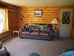 Queen sofa sleeper and single cot add more  accommodations for larger groups! Door to upstairs.