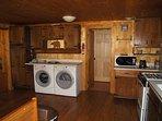 Microwave, toaster, washer & dryer. Door to bedroom and door to the bathroom