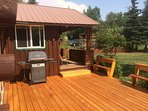 Gorgeous deck off of the living room.  Grill for those scrumptious dinners!
