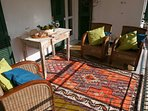 Sun and shade on the big balcony - enough room for 6+  to eat and a few to lounge around