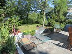 Plenty of seating and lovely gardens welcome you to the patio-160 Long Pond Drive Harwich Cape Cod - New England...