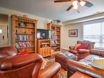 Cozy up on the plush couches to watch the flat screen TV.