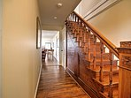 A lovely hand-carved staircase leads to the second floor.