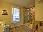 Step in the walk-in shower for a quick rinse.