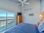 Oceanfront master bedroom with king size bed, flat screen TV, private bath and sliders to the oceanfront balcony.