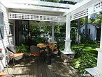 Back porch off professionally landscaped gardens