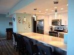 Enjoy morning meals at this beautiful kitchen bar!