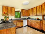 Kitchen with Koa (Kauai most valuable wood) cabinets. Crockpot, Vitamix blender, coffee maker, etc