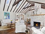 living room with vaulted ceiling!