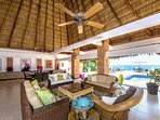 Relax under our large palapa with a good book.