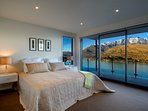 all 4 bedrooms have TVs, mountain and lake views