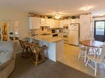 Fully equipped kitchen with full size appliances, cookware, dishes and tableware are on hand.