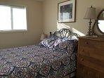 Queen bed with antique dresser