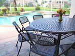 Sunny, heated pool; spillover spa, propane gas grill; patio dining for 8-12 in lanai.  Fence removes