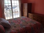 Guest bedroom with queen bed and sliders to balcony with ocean view!