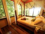 Spacious guest bedroom with 180 degree views