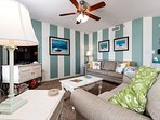 Beach front living room offers amazing views of the beach and su