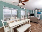 Open dining area features beautiful beach view!