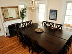 Beautiful wood dining room can seat 14-16 people.