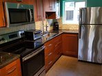 Brand New Kitchen with Stainless Steel Appliances and Granite Counters