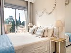 1st floor double bedroom with access directly to the sunny terrace with sea views