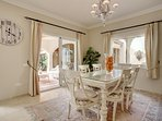 Comfortable dining room adjacent to the kitchen and with access to the covered terrace