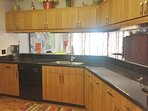 Remodeled kitchen - quartz countertops and new wood flooring.  Fully equipped for your needs.