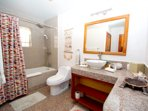 Guest bathroom with granite counters and bath tub/ shower combo