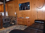 The Living Room, Featuring Comfy Furniture, a Wood-Burning Stove, and a Large Flatscreen TV