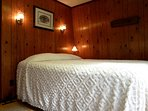 The Master Bedroom Features a Queen Size Bed