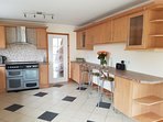 Modern fully equipped kitchen with breakfast bar & dining area.